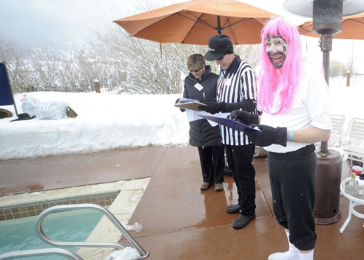 Judge Ron Spangler scores a team during the Penguin Plunge.