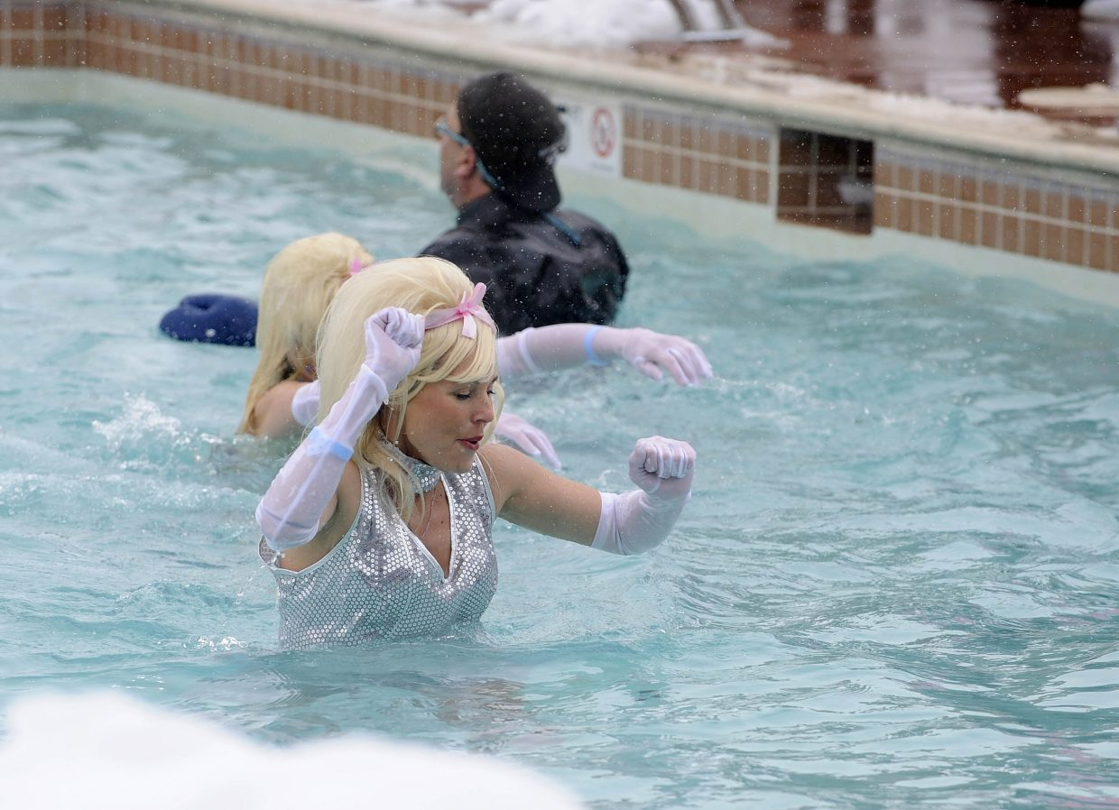 Melissa Welu hurries to the other side of the pool during the Penguin Plunge.