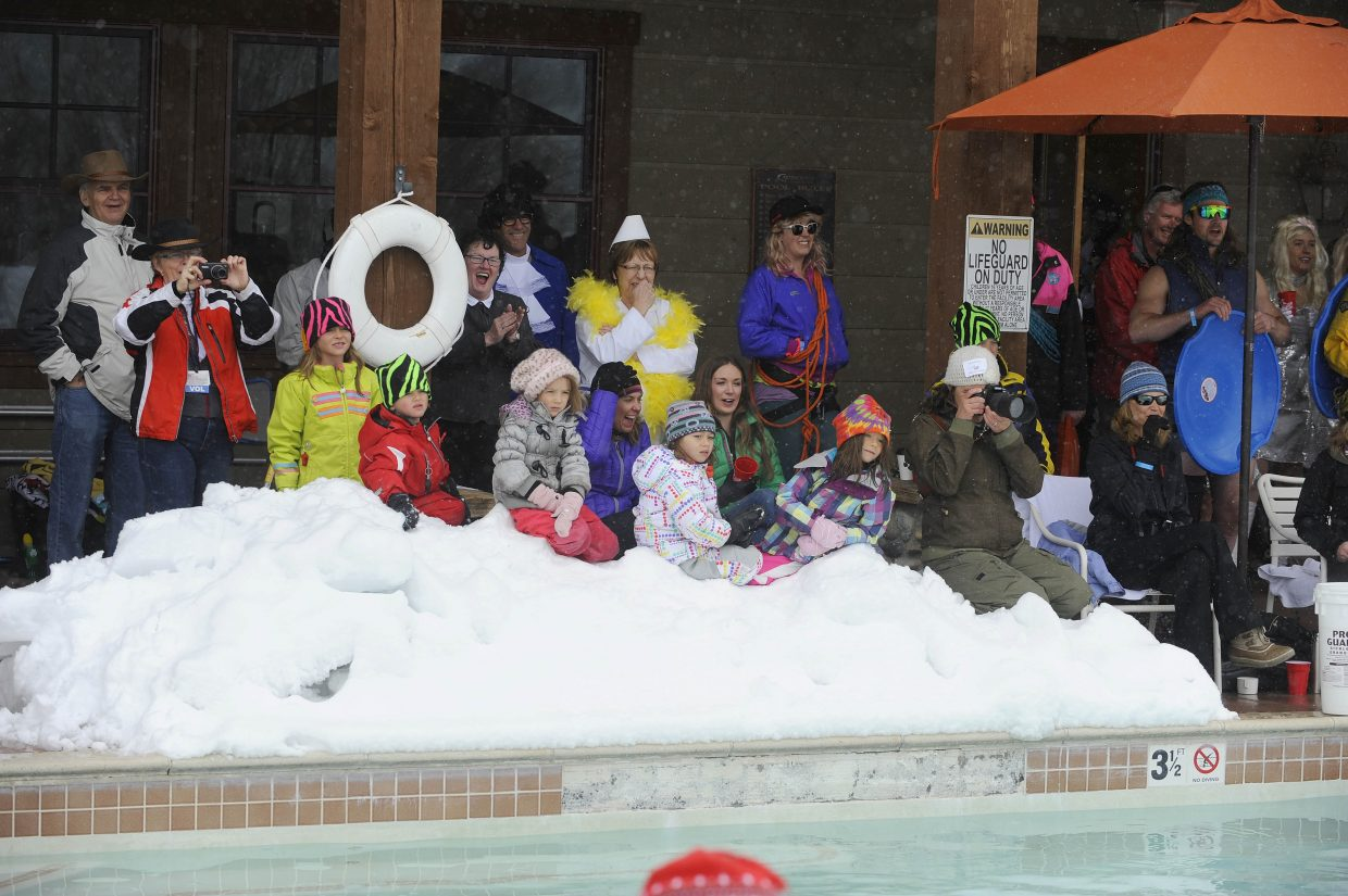 Spectators watch as a team jumps into the pool during the Penguin Plunge.