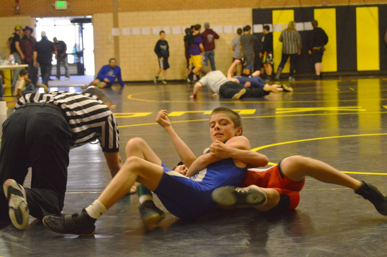 Craig Middle School's Joe Neal maintains control over Steamboat Springs' Cash Meyring in the opening round of Saturday's Western Slope Championship in Meeker. CMS wrestlers will move on to a regional qualifying event in Grand Junction this weekend.