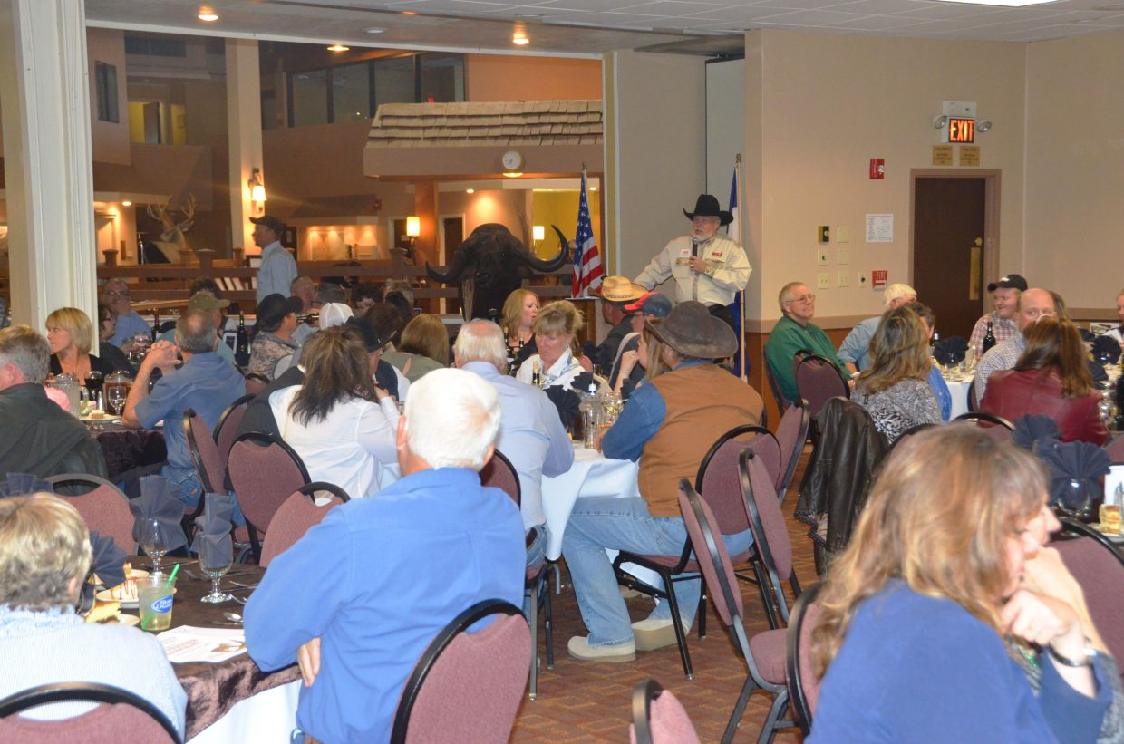 Emcee Steve Blackwell discusses the work of Safari Club International while diners tuck into their meals at the SCI Yampa Valley Chapter fundraiser banquet Saturday night at the Clarion Inn & Suites. Now in its seventh year, the event saw its biggest turnout yet.