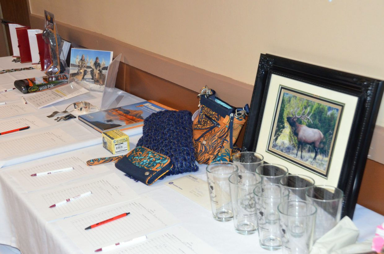 Numerous donated items await bidding for the silent auction at the Safari Club International Yampa Valley Chapter fundraiser banquet Saturday night at the Clarion Inn & Suites.