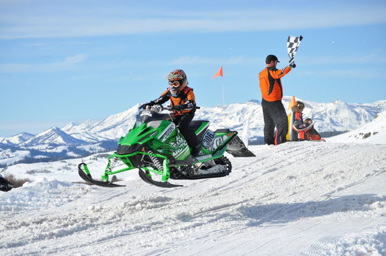 Tallyn Wagner, 10, gets some air during a snocross race. In the past few months, the young speed demon has taken first place honors at numerous events, including three separate races in February in Jackson, Wyoming.