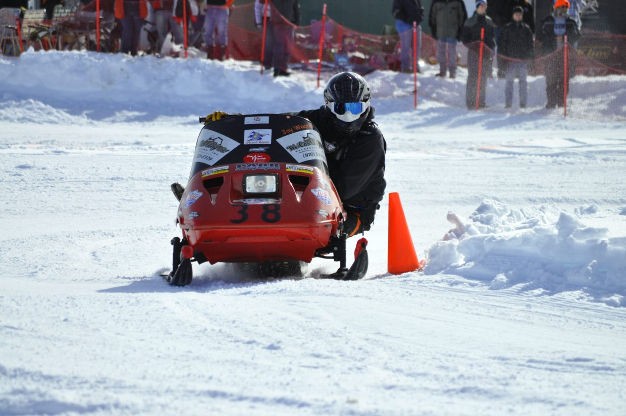 Jay Wagner takes a corner during a Sno-oval race. Wagner and sons Steven and Tallyn competed regular in snowmobile events this winter, most recently in Jackson, Wyoming. Younger son Tallyn, 10, has been racing since he was a toddler and has a corporate sponsor, Arctic Cat.