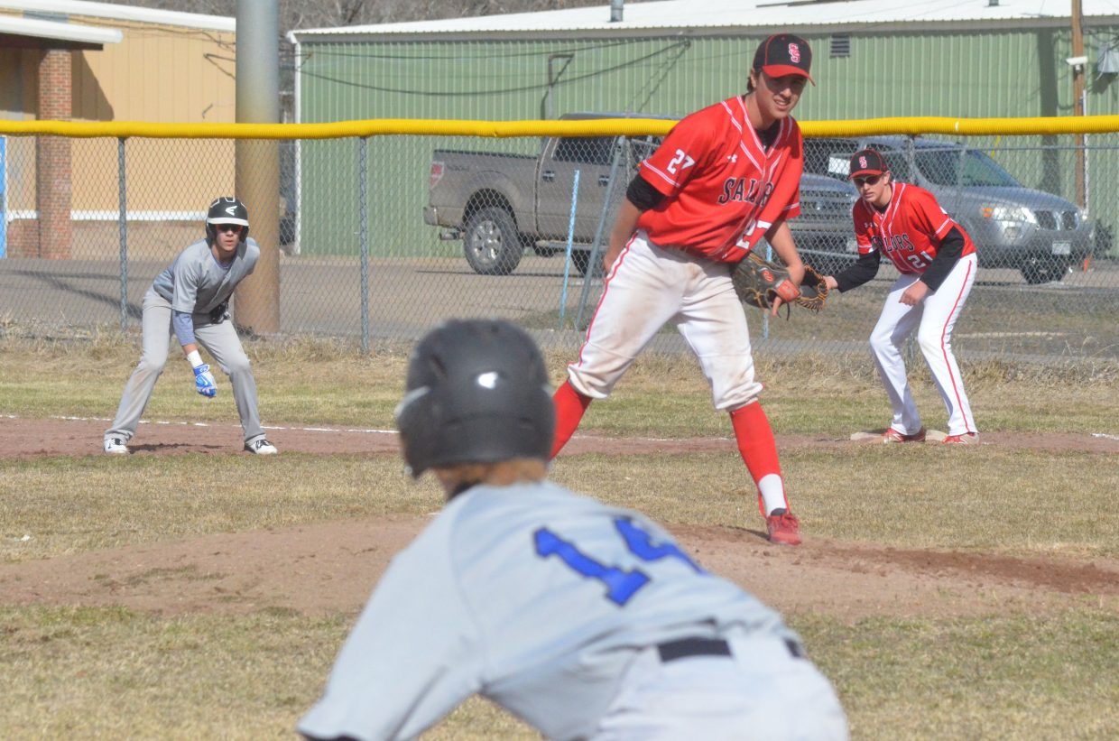 Steamboat Springs starting pitcher Vidal Zuniga keeps an eye on Moffat County's Adain Wilmot on third base during the Bulldogs' Tuesday game with the Sailors at the Craig Middle School field. MCHS varsity baseball lost its first home game, 7-4, the second part of a doubleheader canceled due to snow.