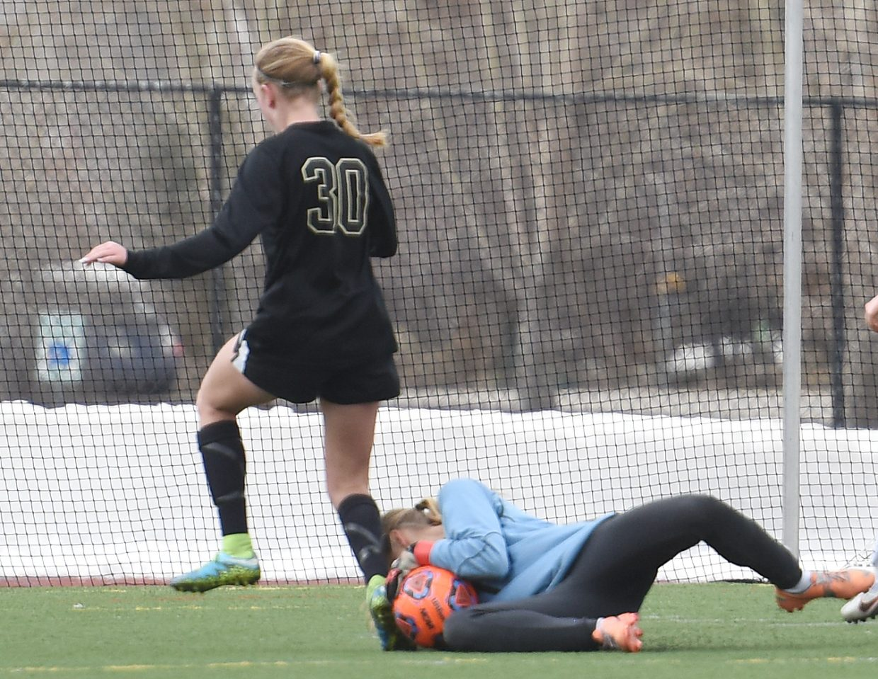 Steamboat goalie Ocoee Wilson scoops a ball off a Battle Mountain foot Tuesday.