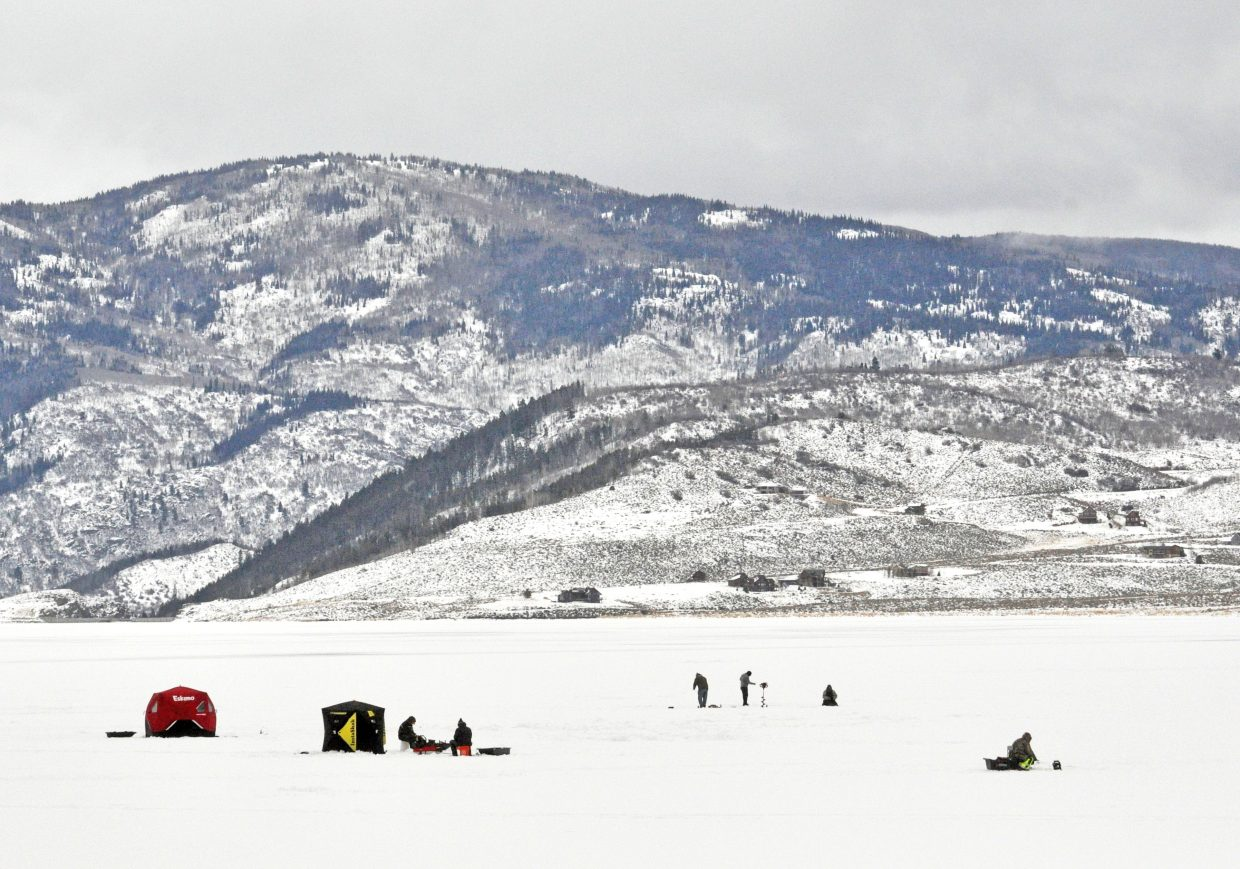 Anglers attempt to catch trout through the ice at Stagecoach State Park in January. A little more than two months later, open water is visible at the inlet, and the ice along the shore is very thin.