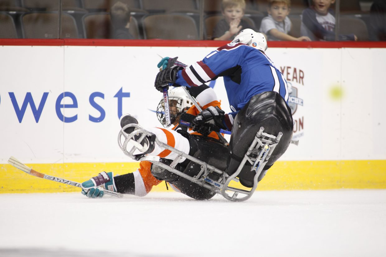 Sled hockey provides plenty of big hits as shown here during the finals of the first annual USA Hockey Sled Classic presented by the National Hockey League Oct. 10, 2010, at the Pepsi Center in Denver.