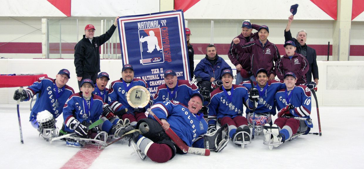 The Colorado Avalanche Sled Hockey team celebrates a national championship in 2011.