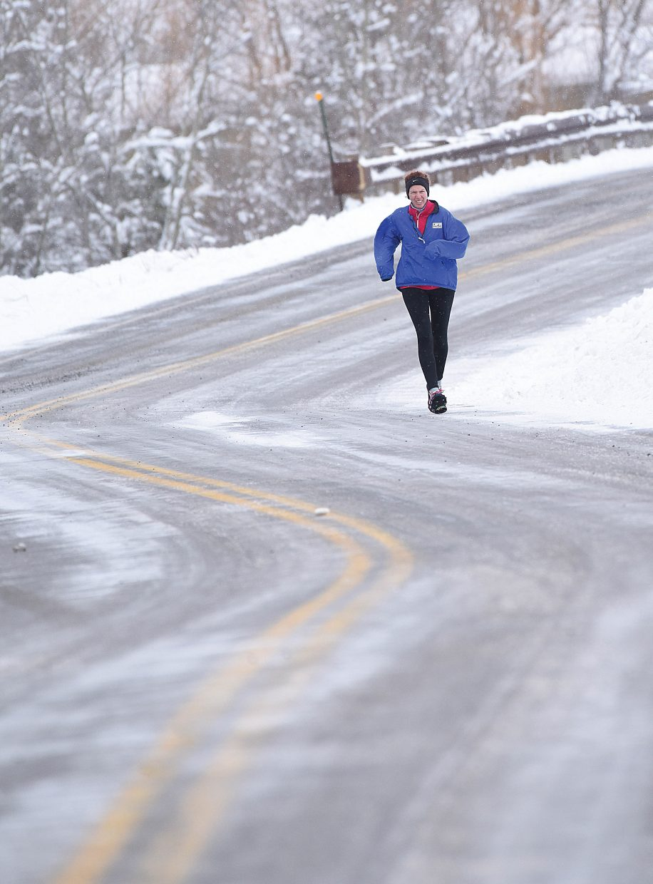 Gina Adamoli didn't let the snow, ice or cold keep her from taking a run Wednesday morning in Steamboat Springs. The warm weather Steamboat experienced earlier this week was a distant as a spring storm swept though the area.