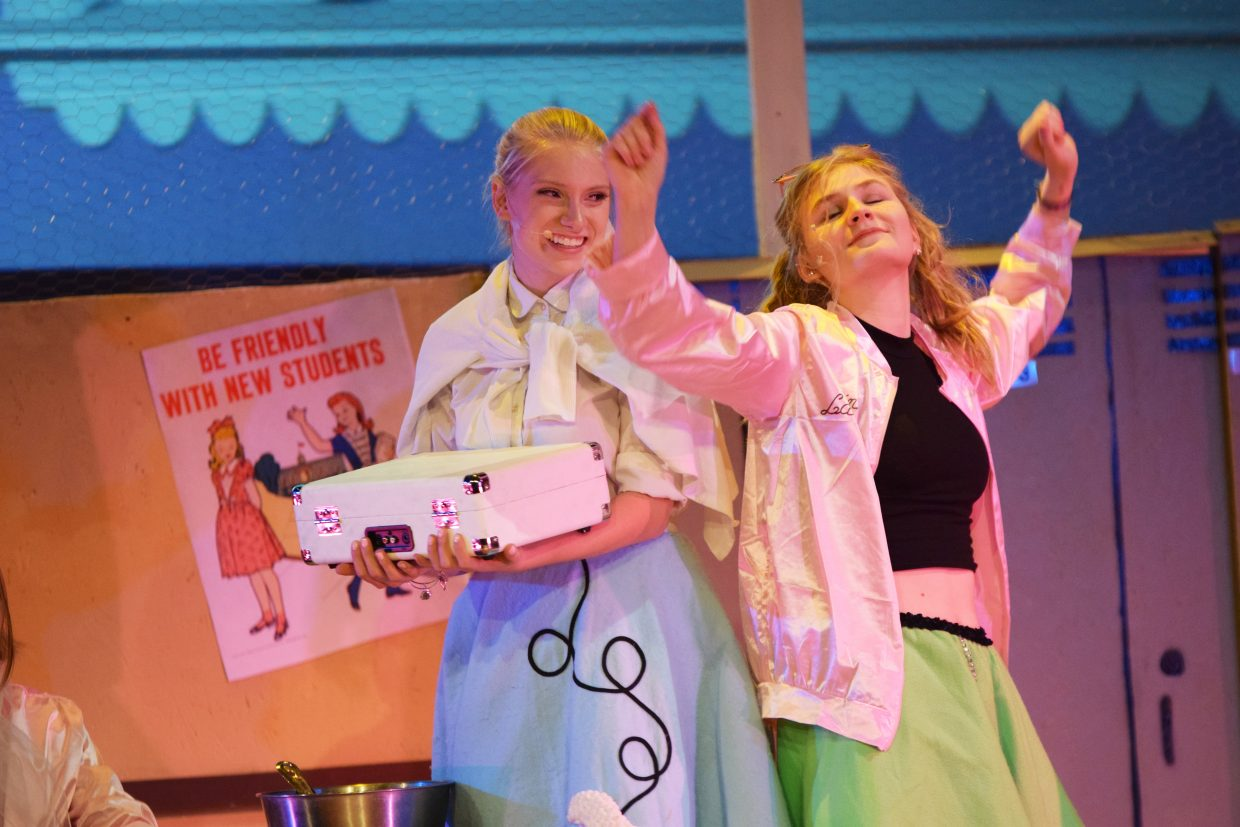"Keala Fraioli, left, plays Sandy Dumbrowski, while Libby Lukens plays Jan, a Pink Lady, in Steamboat Springs High School's production of ""Grease,"" with shows through April 1."