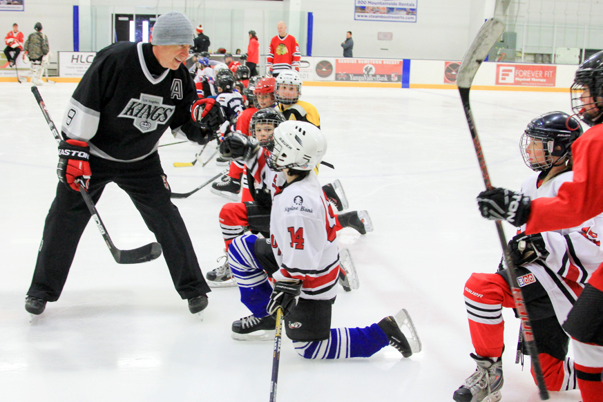 Bernie Nicholls, who played more than 1,100 games during his National Hockey League career, instructs kids during the 2016 Steamboat Hockey Classic at Howelsen Ice Arena. The event returns this weekend and will be capped by an alumni game Saturday evening.