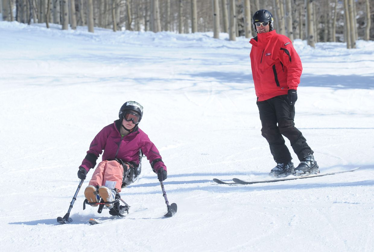 Sit skier Cami Biebuyck and instructor David Schmid cruise down the slopes of Steamboat Ski Area on Monday as part of the Steamboat STARS of Tomorrow Kids Camp. This weekend's STARS Mountain Challenge is a fundraiser to help support Steamboat Adaptive Recreational Sports programs in Steamboat Springs.