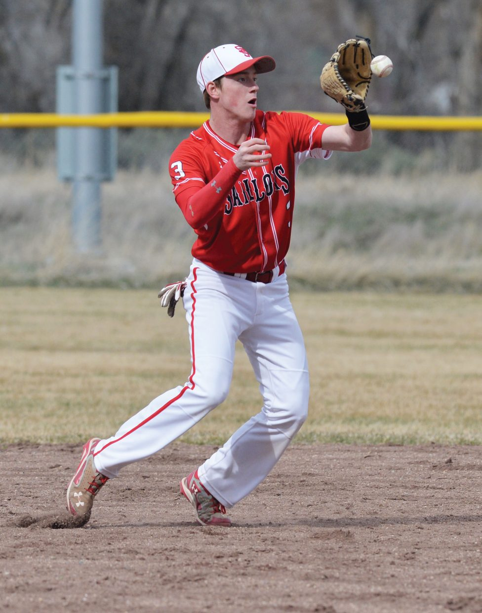 Steamboat Springs shortstop Charles Fitzhugh snags a grounder in the first half of a doubleheader against Summit County Tuesday afternoon in Craig. Steamboat held off a late-inning rally by the Tigers to win the first game 8-7.