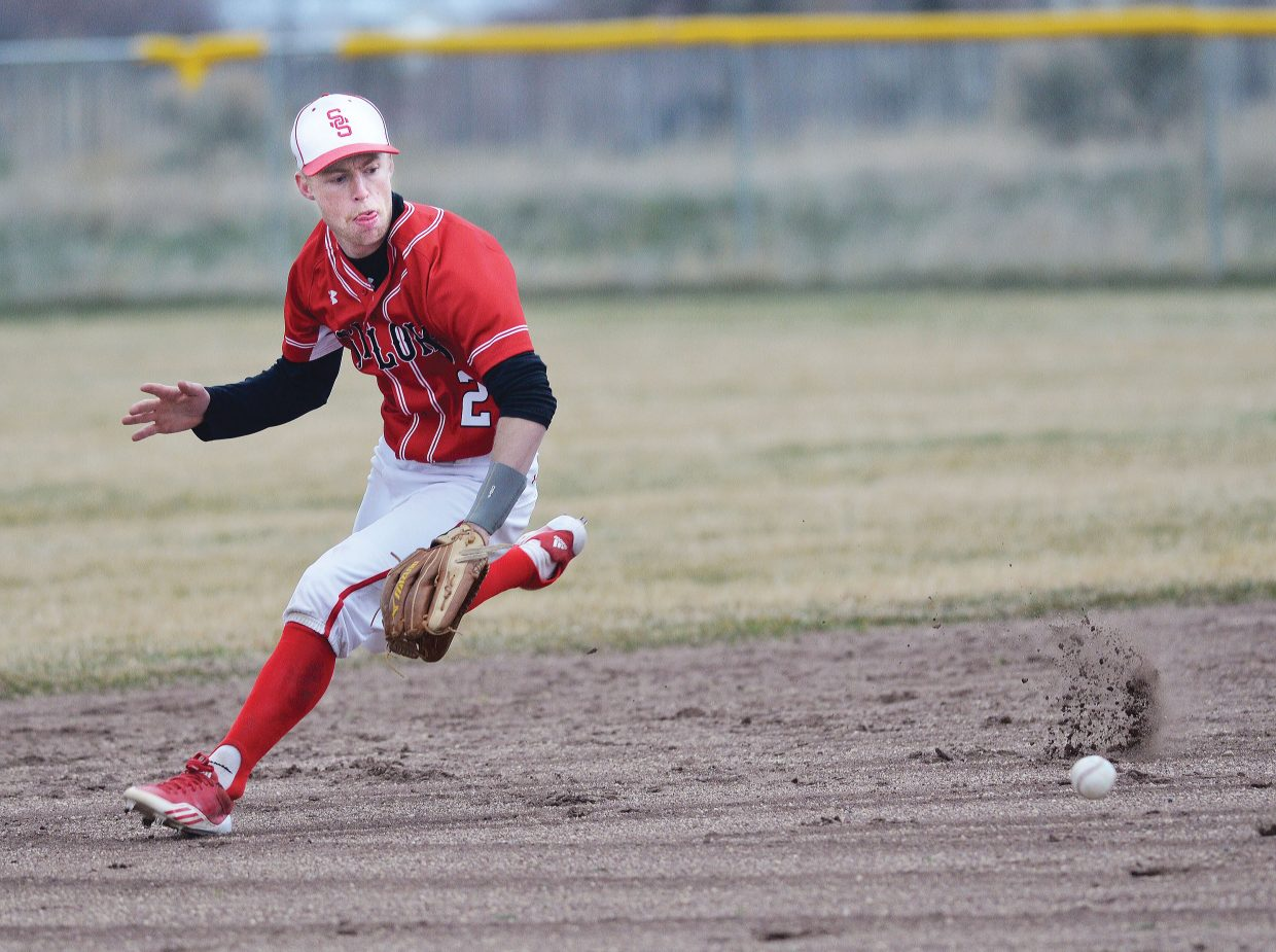 Steamboat Springs Jesse Pugh keeps his eye on the ball in the first half of a doubleheader against Summit County in Craig Tuesday afternoon. The Sailors won the first game 8-7.