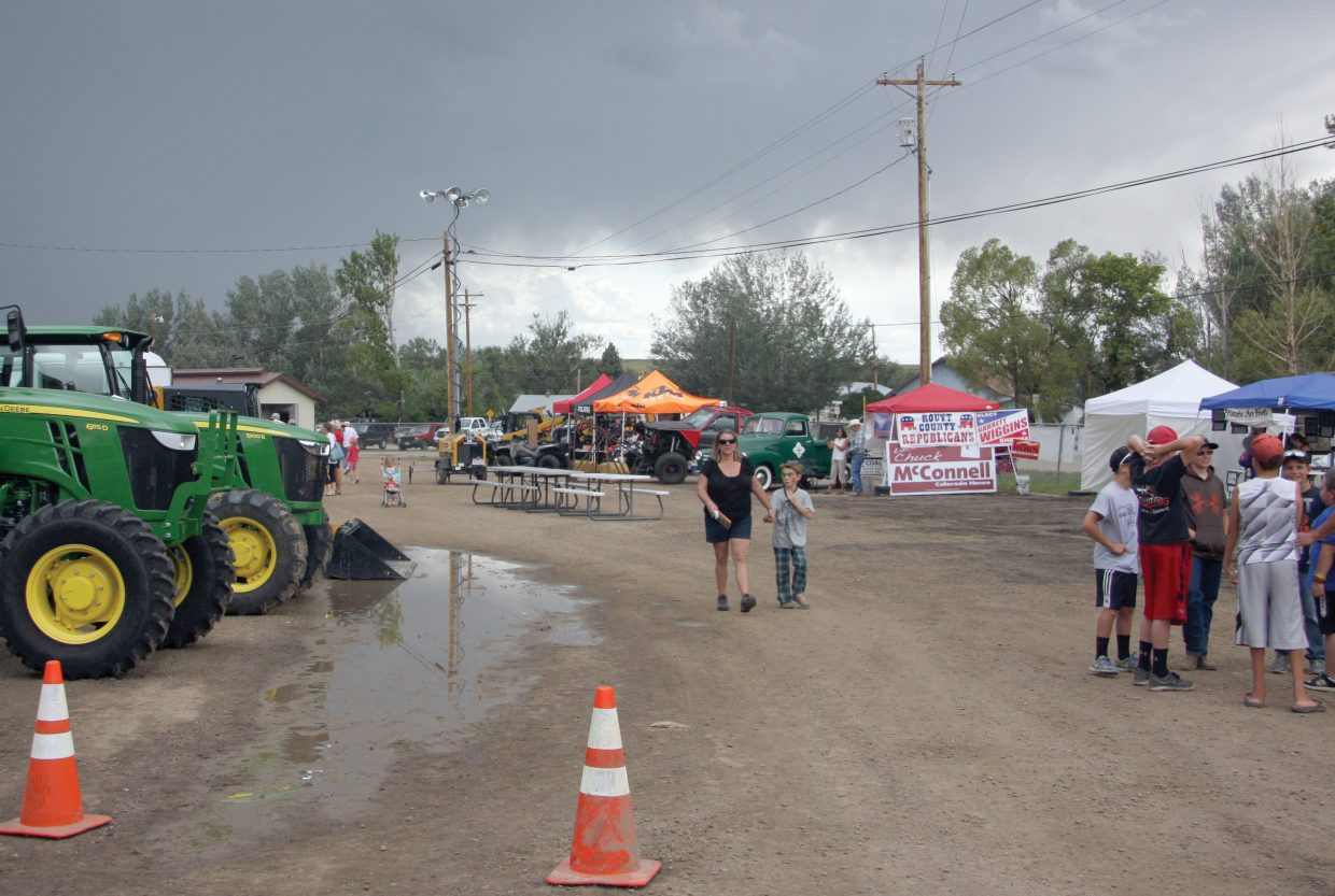 Navigating the midway at the Routt County Fair can mean avoiding mud puddles if the areas where vendors set up tents, and sell food and crafts to the visitors.
