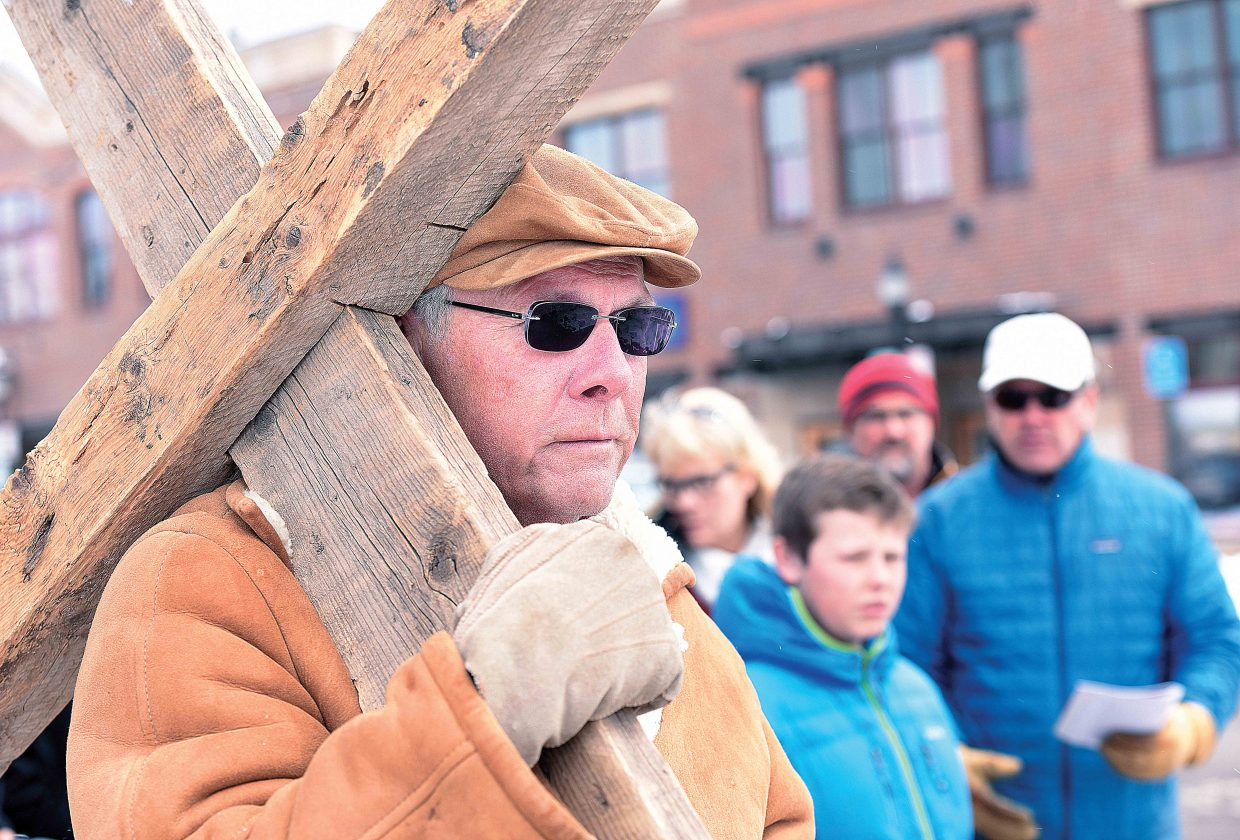 Bing Rekker takes his turn carrying the cross Friday afternoon as part of the annual Stations of the Cross. The Stations of the Cross is a symbolic pilgrimage highlighting the suffering of Christ as he made his way to Calvary. The group visited 14 locations in downtown Steamboat Springs, stopping at each for a few moments of prayer. The annual remembrance is one of many events leading up to Easter Sunday.