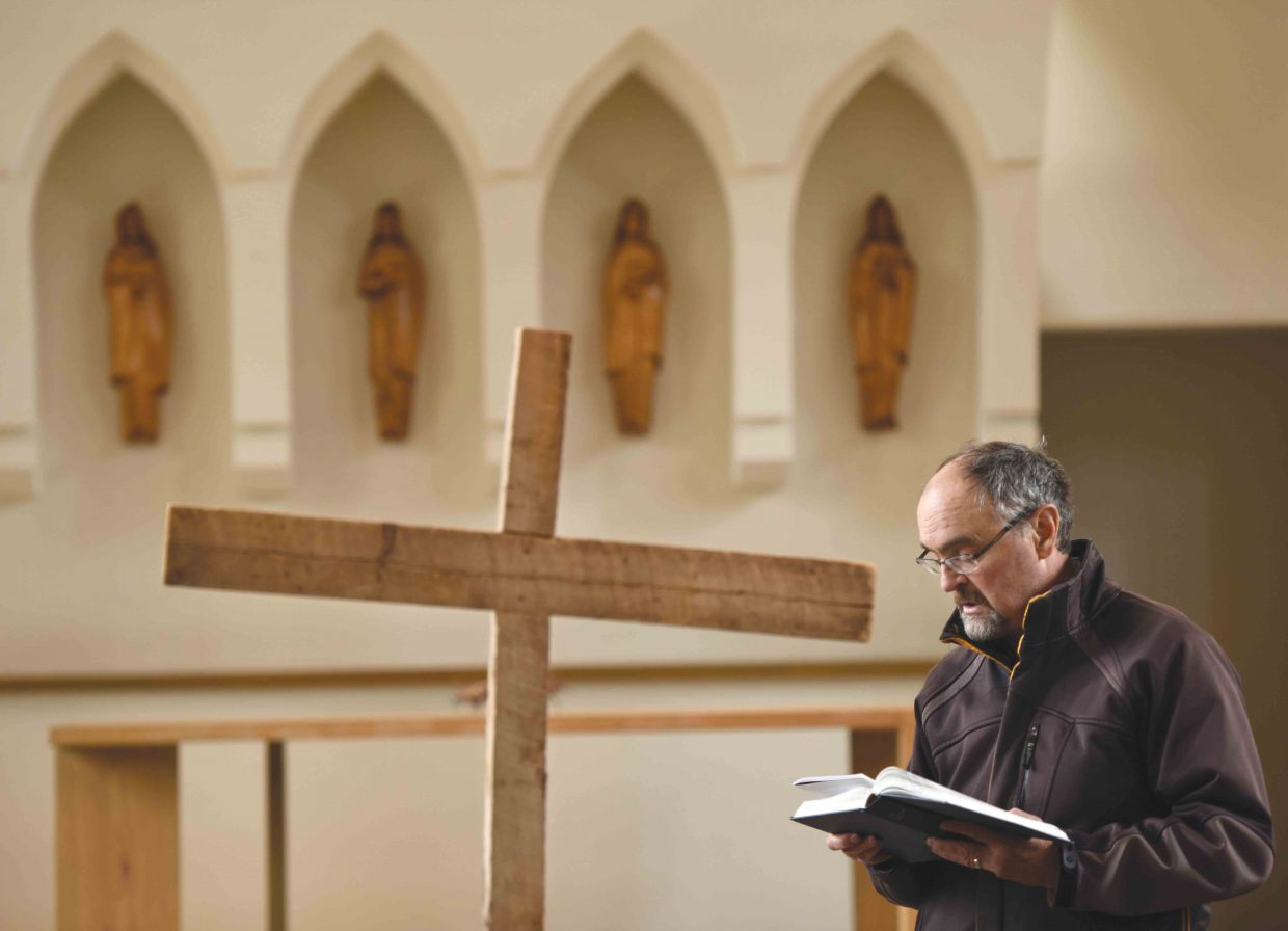 Del Lockhart reads a passage Friday as part of the Stations of the Cross, a ceremony during which Christians remember Jesus Christ's final day on Earth through prayer. This weekend, Christians around the world will celebrate the resurrection of Christ on Easter Sunday.