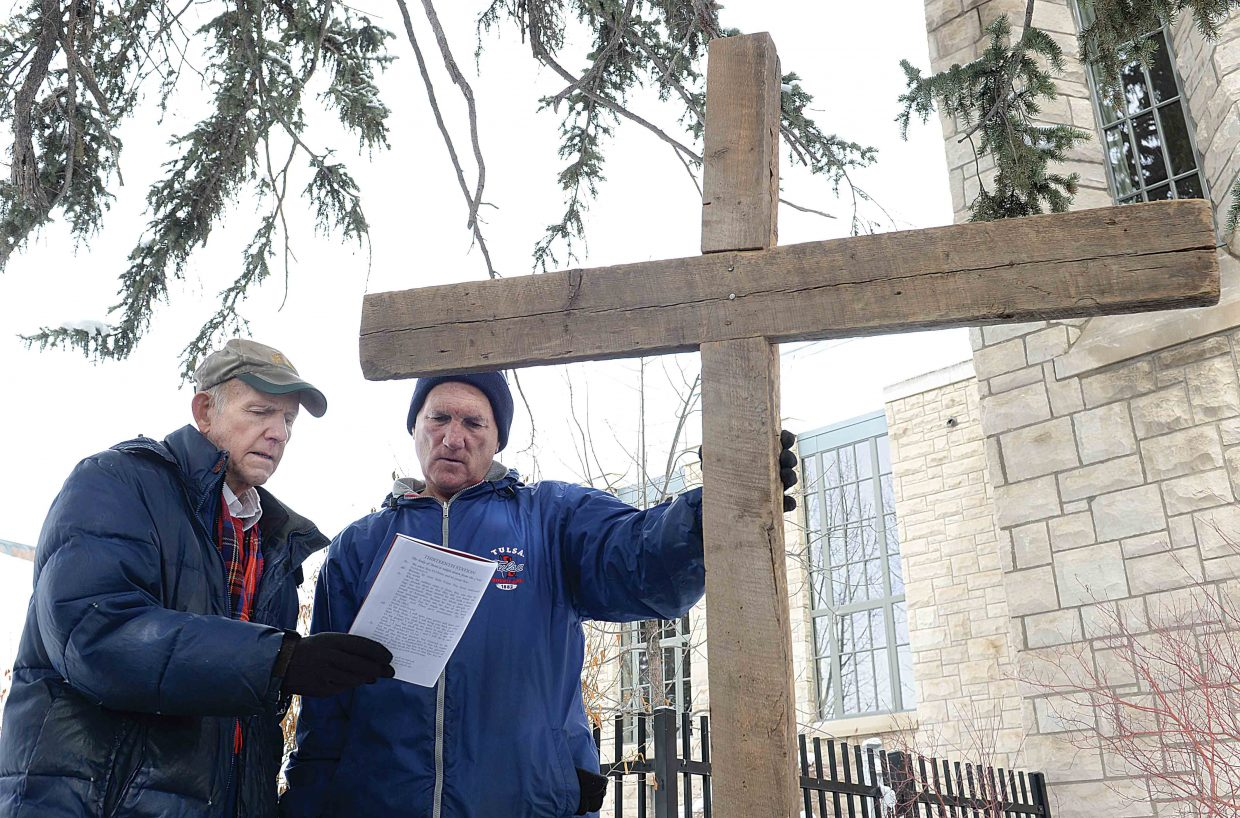 Bill Padgett and Mark Drake read a passage Friday as part of the Stations of the Cross, a ceremony during which Christians remember Jesus Christ's final day on Earth through prayer.