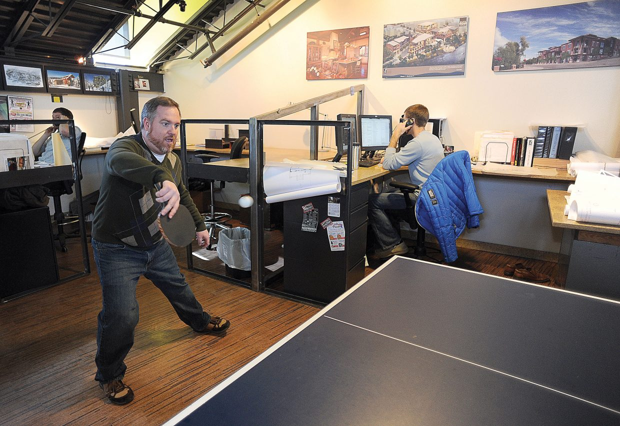 Matt Parker, business manager for Vertical Arts Architecture in Steamboat Springs, plays pingpong with principal Brandt Vanderbosch during a work break. The fourth annual Paddle Battle will take place from 1 to 9 p.m. Saturday at the Tennis Center at Steamboat Springs and McKnight's Irish Pub & Loft.