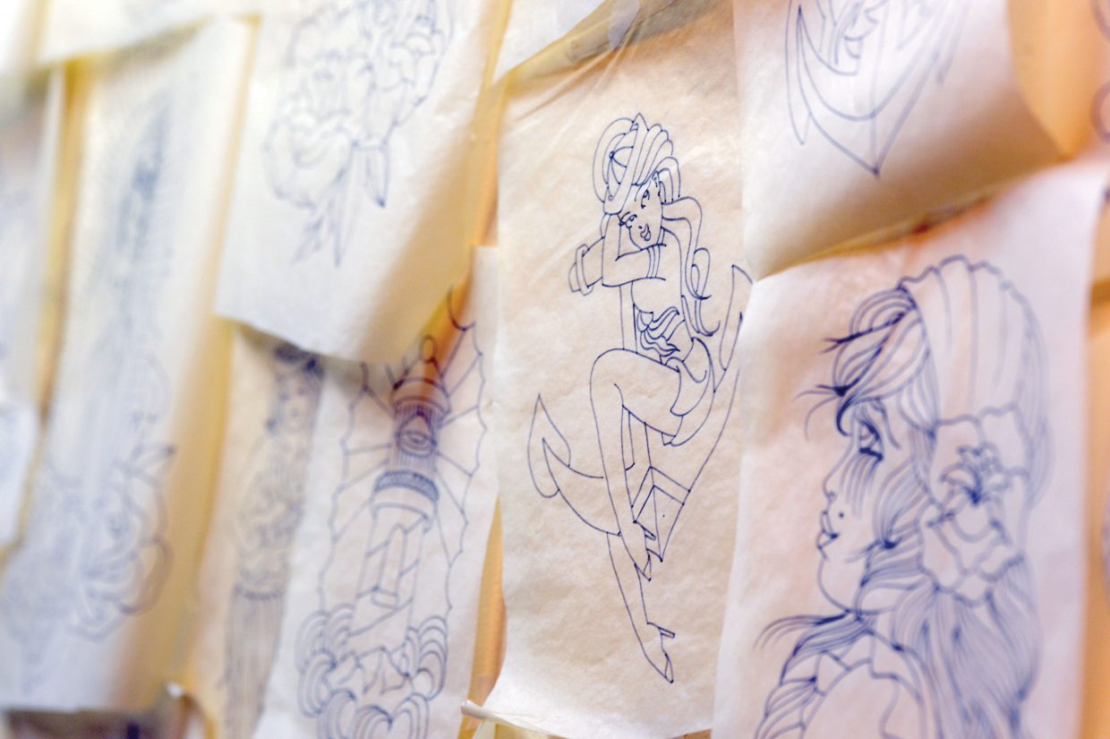 The drawings used to create tattoos line the walls of Melissa Freeman's studio in downtown Steamboat Springs. Freeman says each tattoo is unique and made specifically for each client.