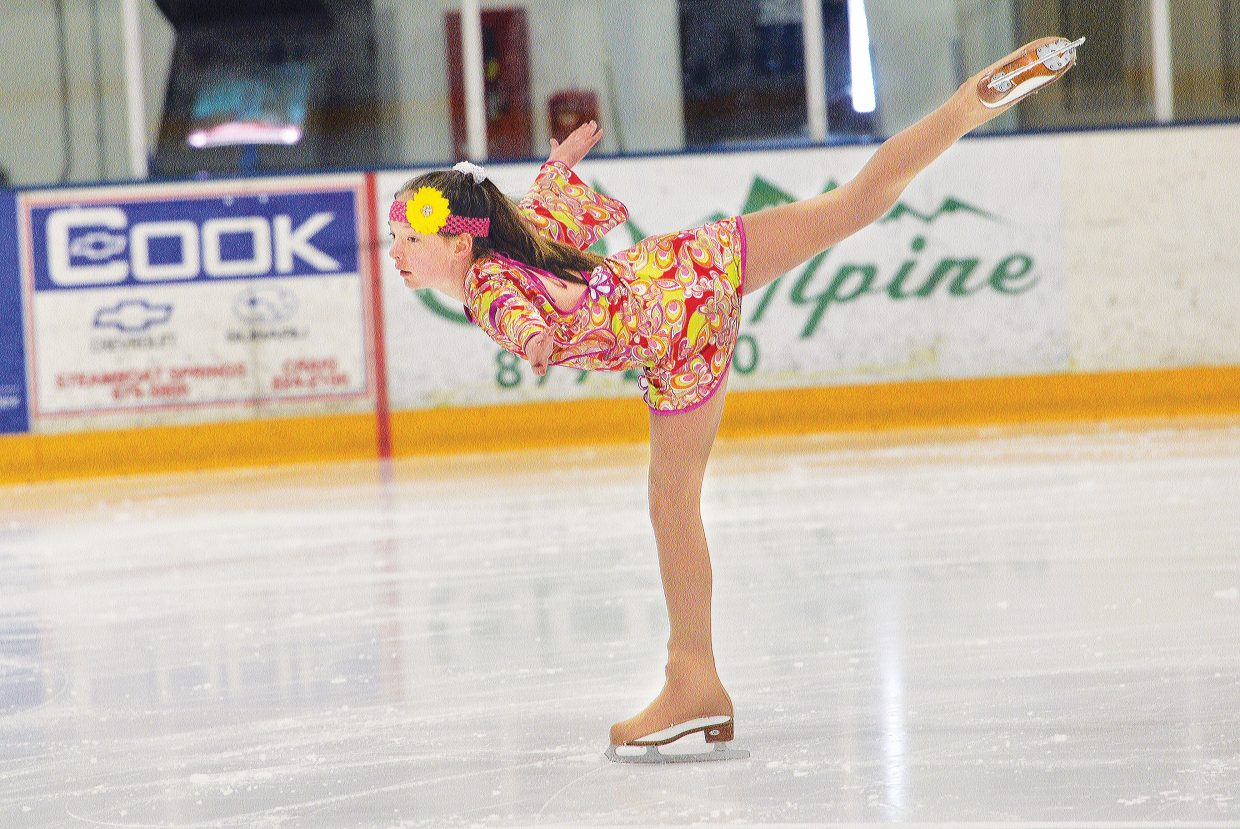 """Steamboat Springs Figure Skating Club member Natasha Curzon performs to """"I'm a Believer"""" during a rehearsal for Sunday's Spring Show. The show is scheduled to begin at 4:30 p.m. at the Howelsen Hill Ice Arena. Admission is free, but the figure skating club will be asking for donations to help support its programs."""