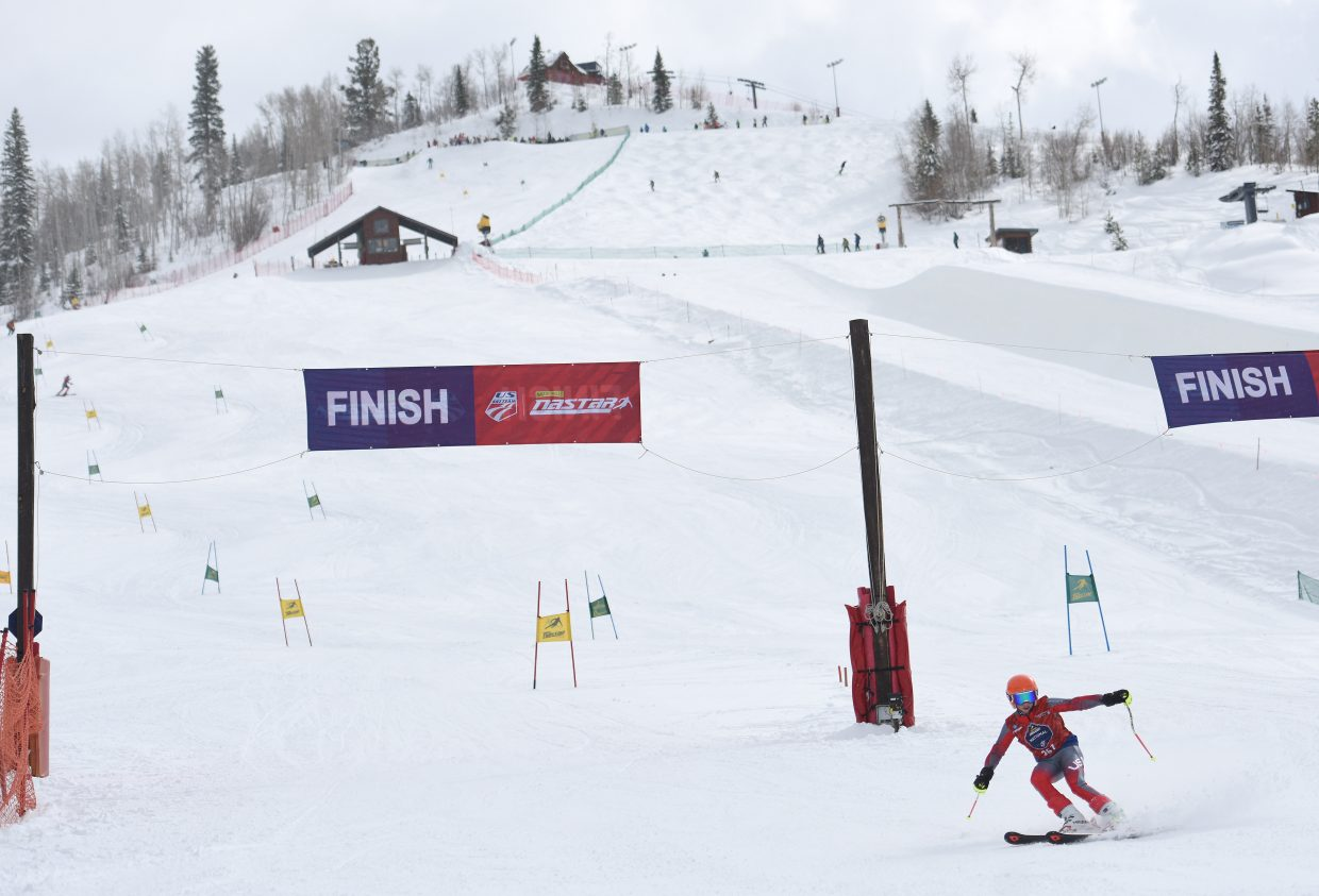 A skier slides to a finish during the NASTAR National Championships on the Bashor giant slalom course on Saturday at Steamboat Ski Area.