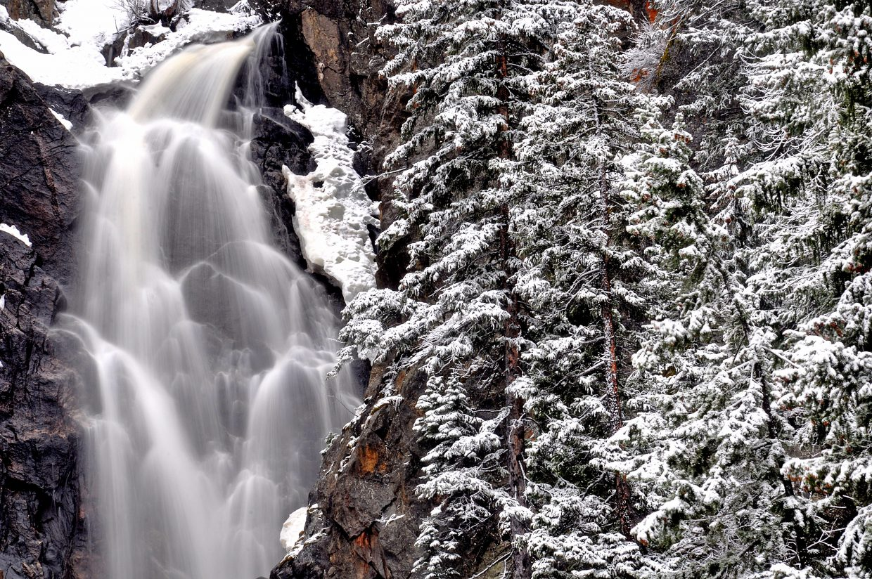 Fish Creek Falls run fast after a spring snowstorm Sunday morning. More snow is possible this week in Steamboat Springs.