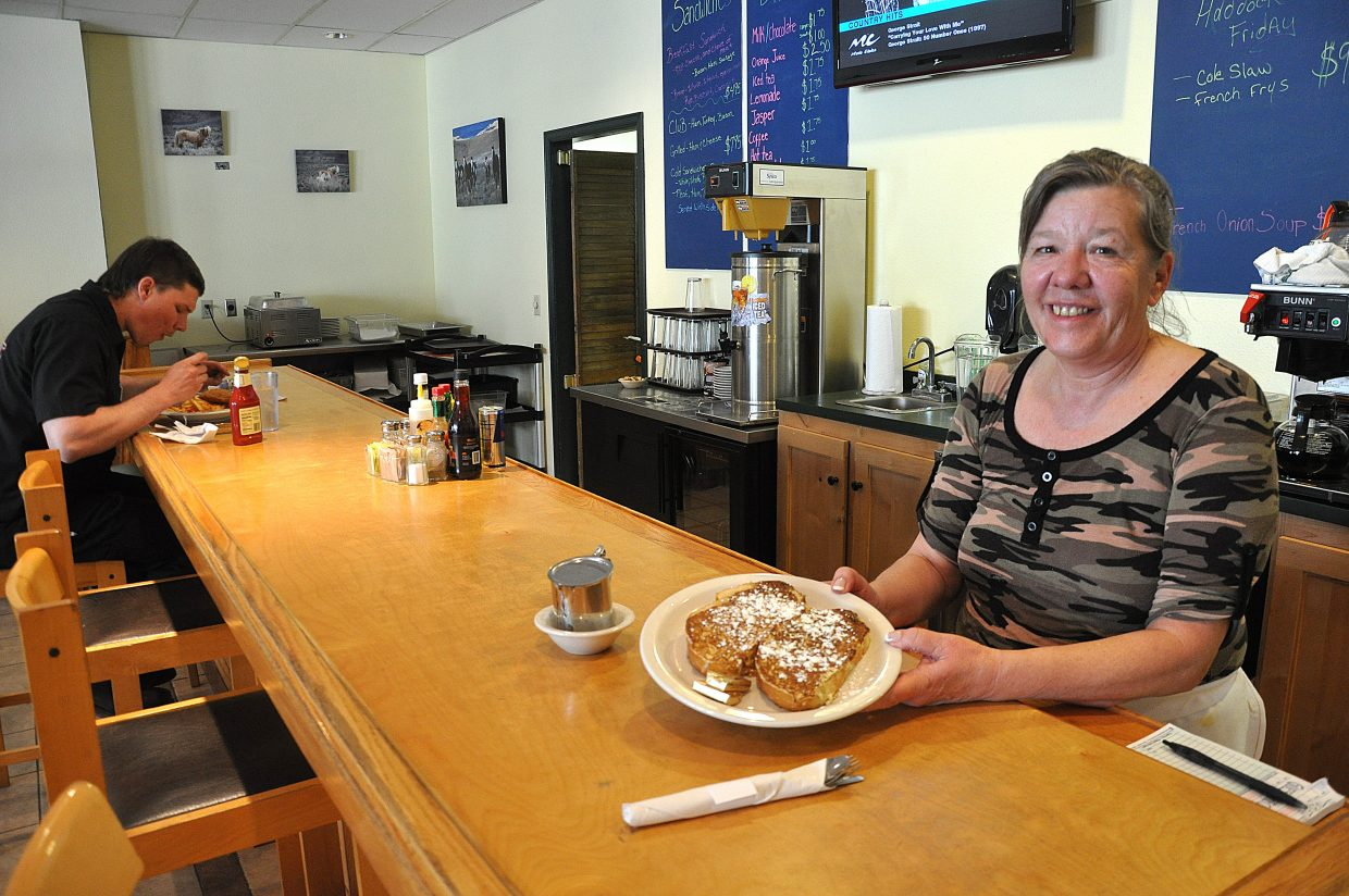 Sharon Stone shows off the French toast at her new restaurant in Riverside Plaza.