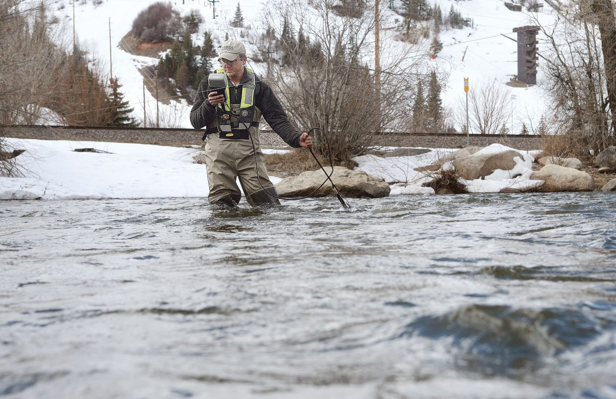 Terry Petrosky, who works for the U.S. Geological Survey, tests the water flowing down the Yampa River on Thursday afternoon. Petrosky said the Geological Survey tests the water for a number of different things, including everything from nutrients to chemicals.