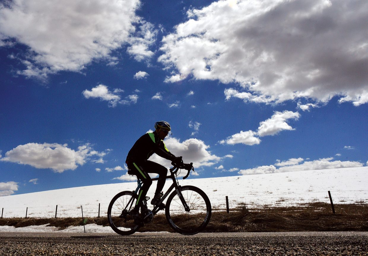 Cyclist Steve Fleckenstein makes his way along Routt County Road 33 Friday afternoon.