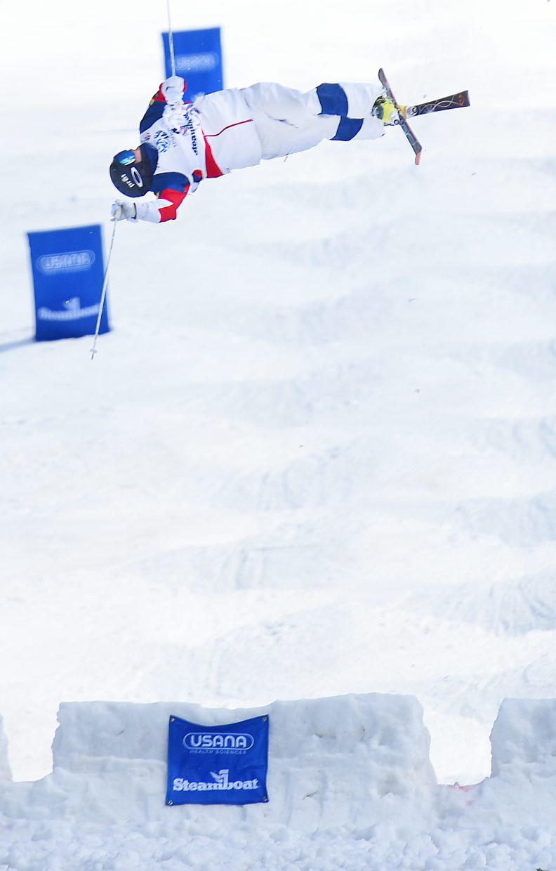 Troy Murphy spins through the trick on the second kicker of the moguls course Friday.