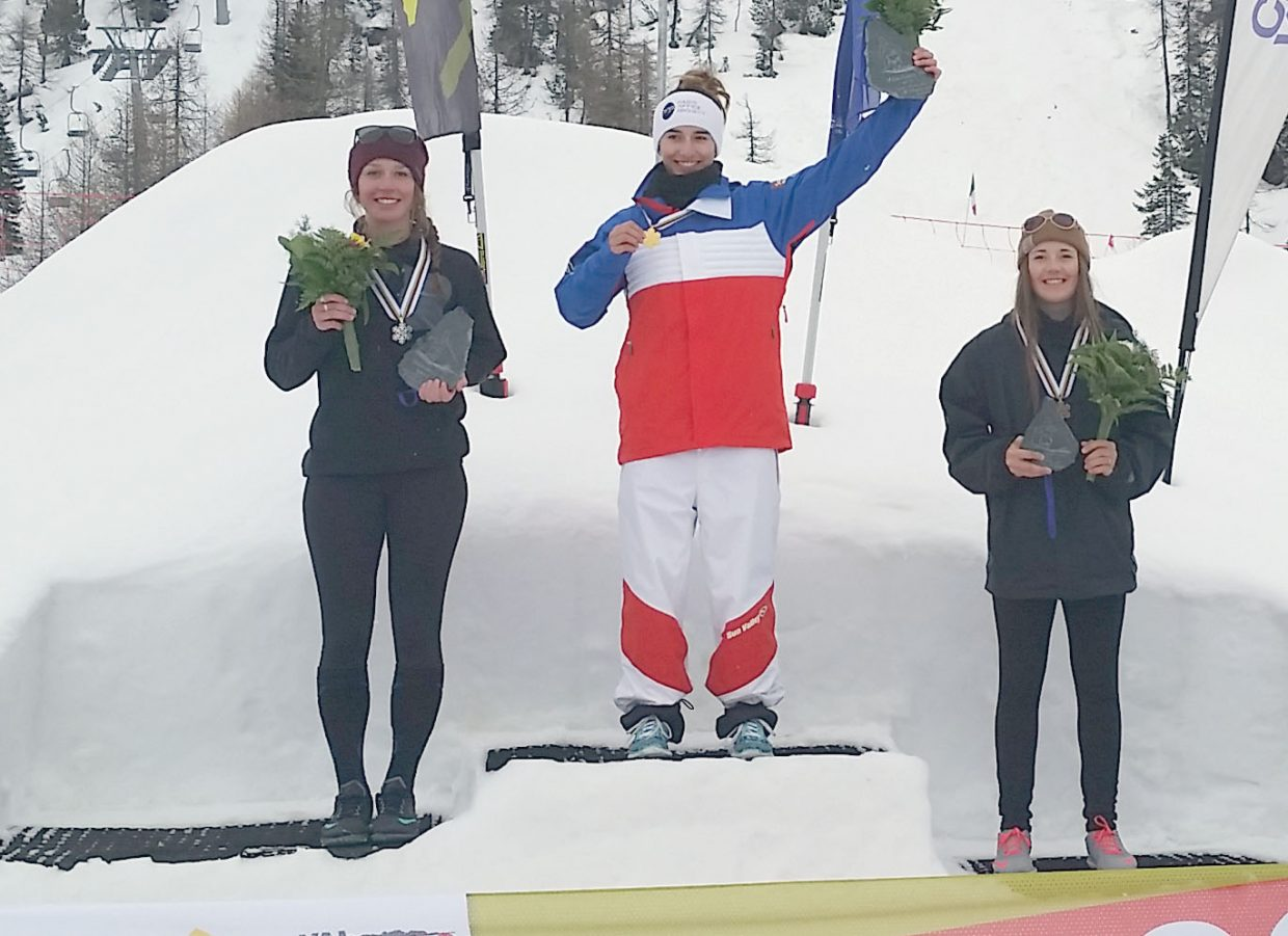 Women's mogul winner Perrine Laffont of France, center, is joined by second place finisher Avital Shimko, left, and third place finisher Jaelin Kauf on the podium of the Junior World Freestyle Skiing Championships. Both Shimko and Kauf are members of the Steamboat Springs Winter Sports Club.
