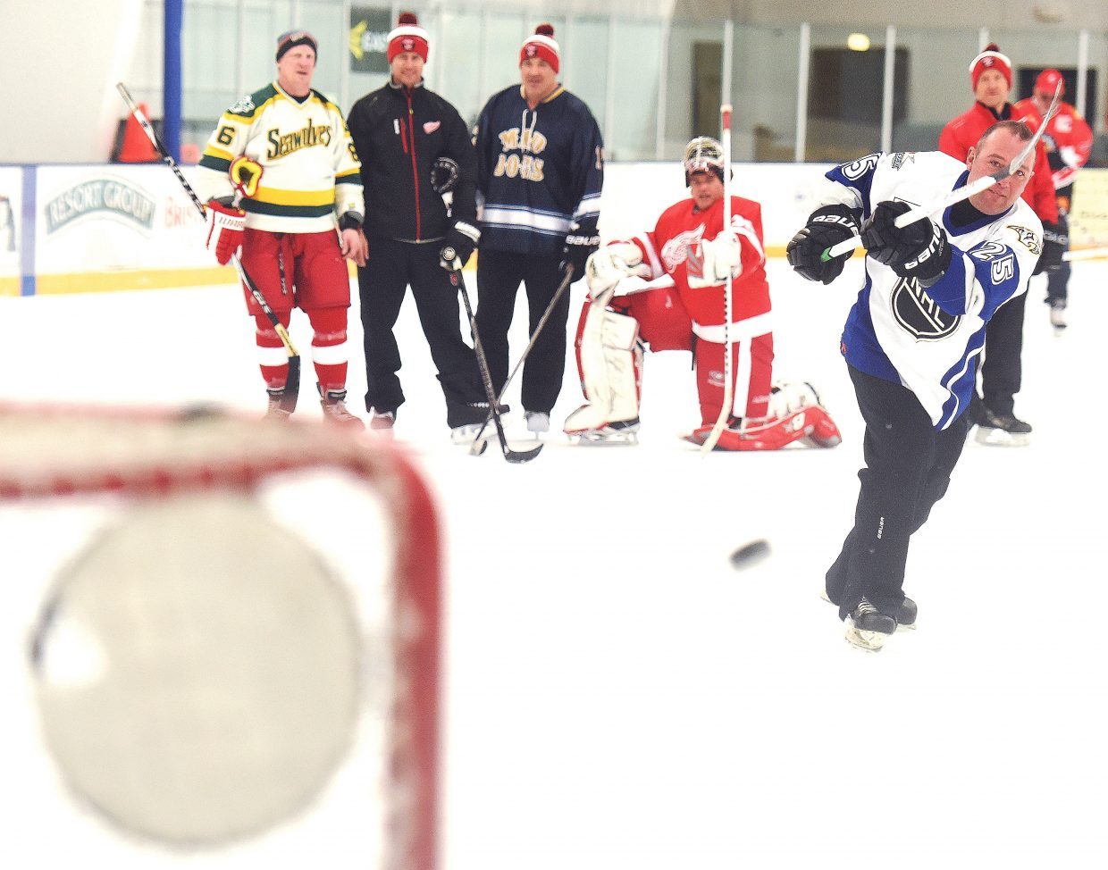NHL alum Sergei Krivokrasov fires a shot at a target in the goal Friday night during a fundraiser for youth hockey at Howelsen Ice Arena in Steamboat Springs. Krivokrasov, a Russian, played for 450 games in a career that included 10 years in the NHL and several stints with Russian clubs. He was among the skaters who took part in the fundraiser on Friday. The event continues today with a game between former players from the Detroit Red Wings and the Chicago Blackhawks.