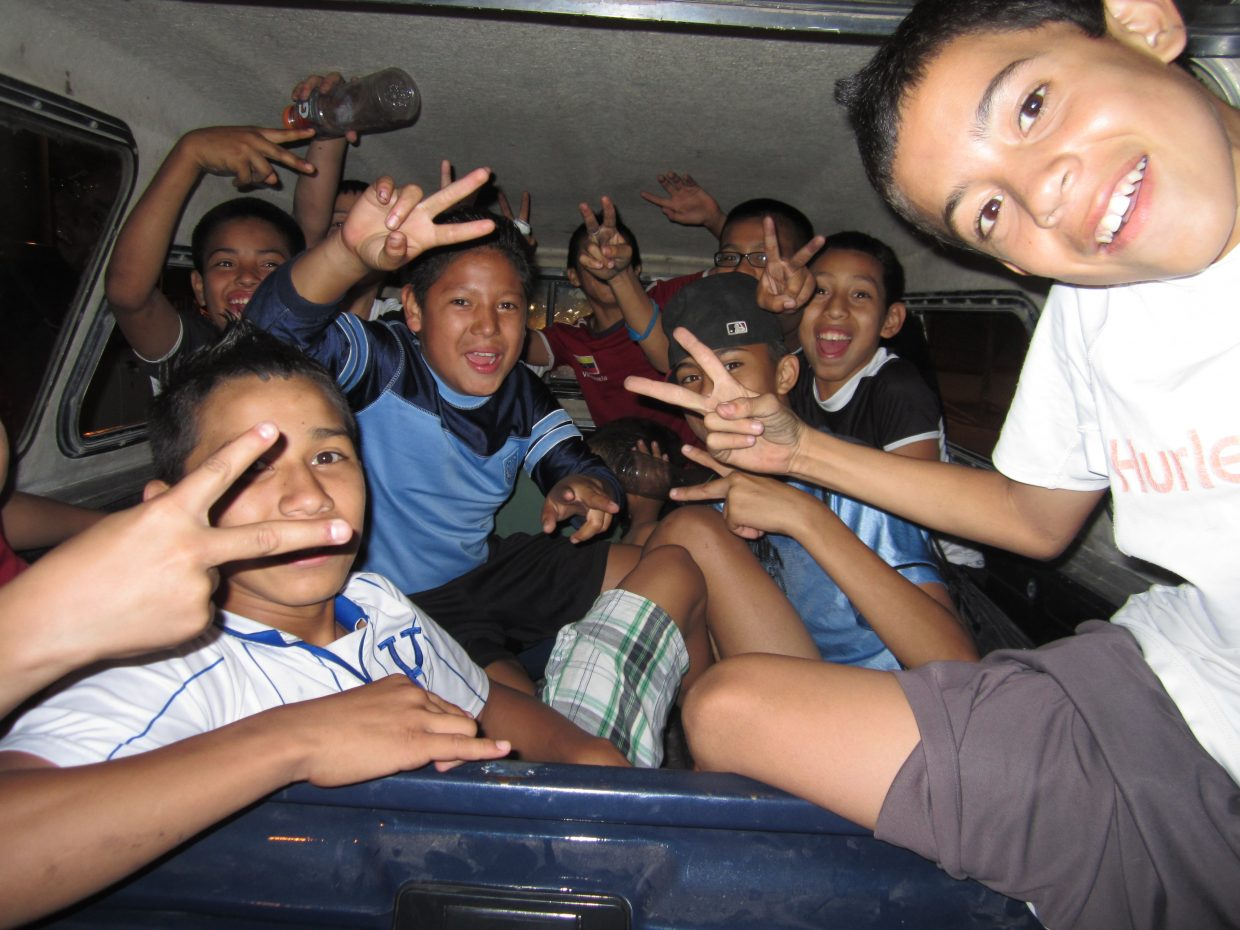In Tegucigalpa, Honduras, kids from the slums shuttle to their game by piling in the back of a pickup. Rich or poor, a focus on youth leads to success.