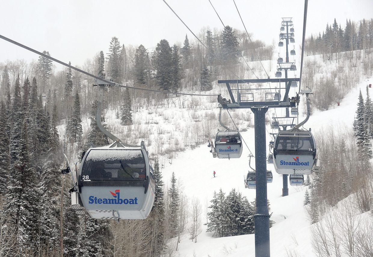 Gondola cars carry skiers up the slopes of the Steamboat Ski Area Friday afternoon.