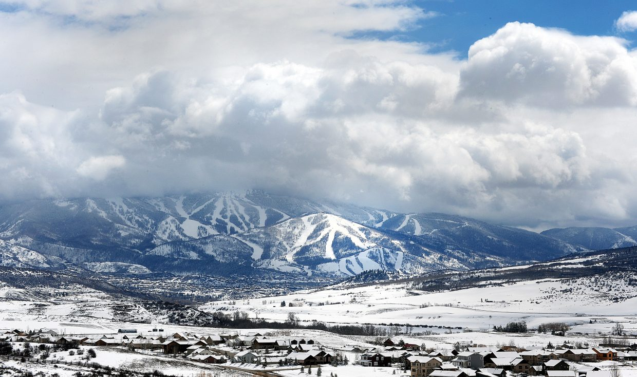 The clouds above Steamboat Ski Area break up Friday afternoon after a spring storm moved through the area.