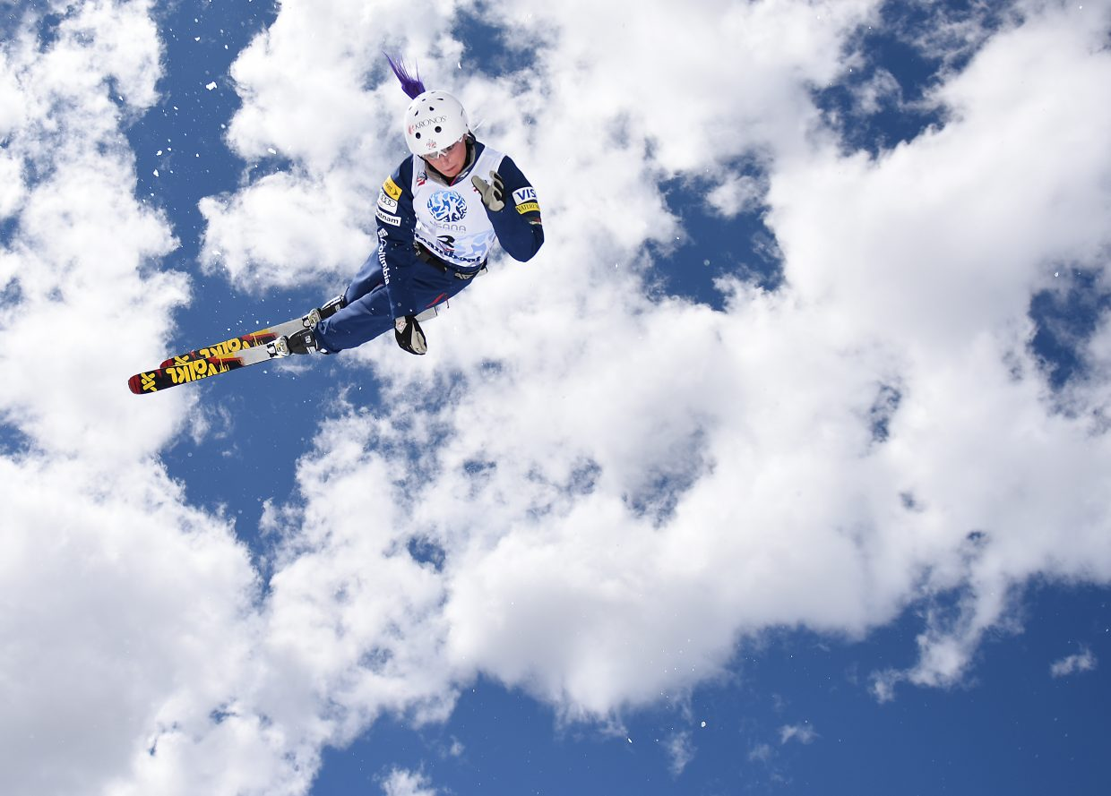 Kiley McKinnon twists through a trick Saturday in Steamboat Springs. She won the overall women's World Cup aerials title earlier this month.