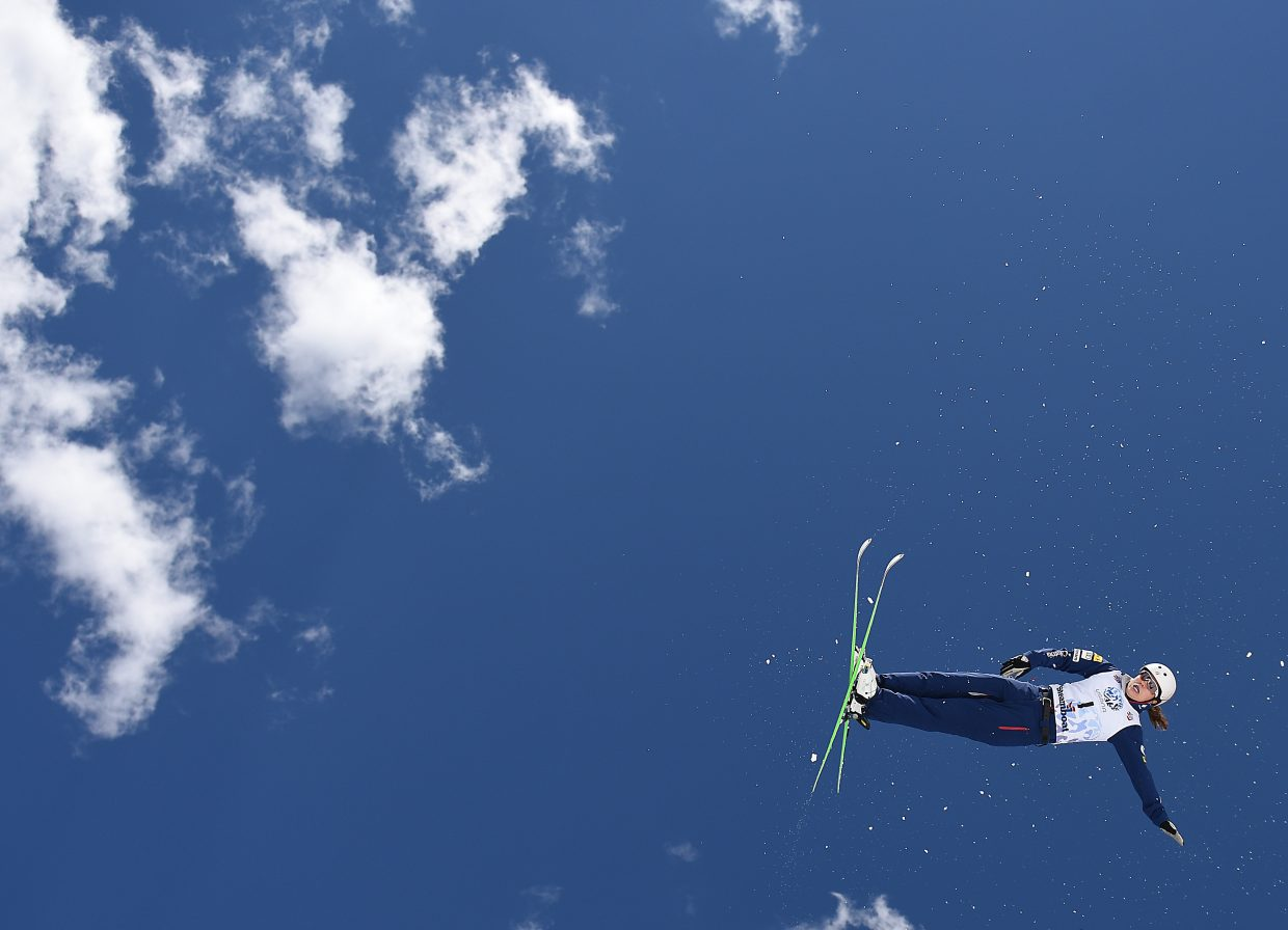 Ashley Caldwell flies through the air in Steamboat Springs on Saturday. Caldwell went on to win the aerials national championship. She's among a pack of skiers who came to the U.S. Team from gymnastics and are helping push the program forward.