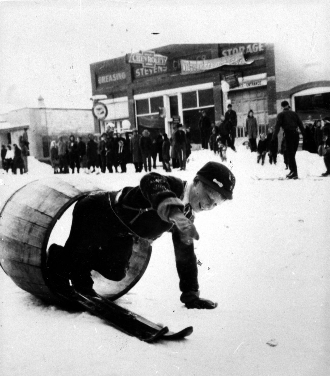 Eight-year-old Buddy Werner tries the Winter Carnival barrel. (Tread of the Pioneers Museum/courtesy)