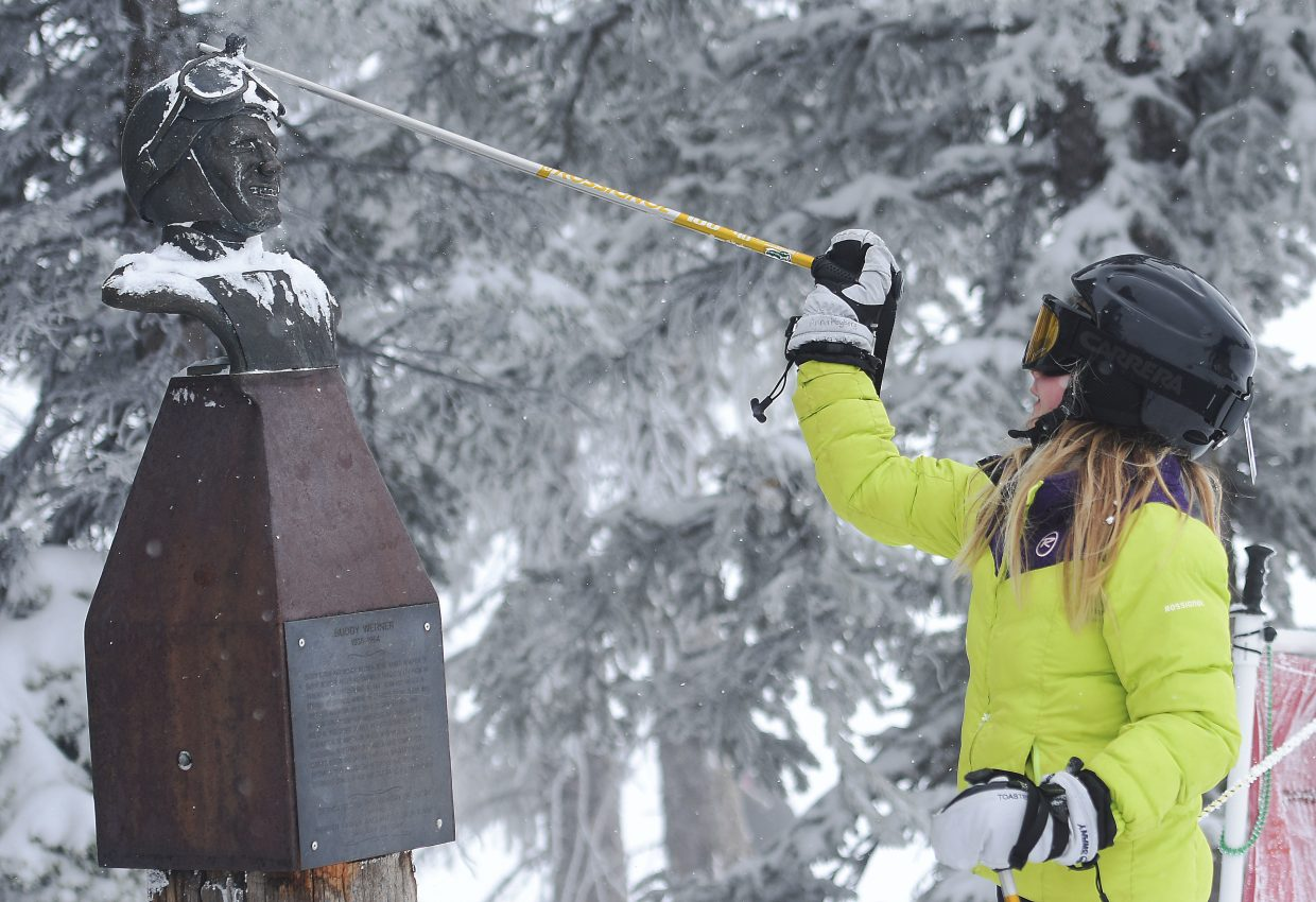 Anna Hagberg, 10, of Erie taps Buddy's statue with her pole Thursday before a run down Buddy's Run at Steamboat Ski Area. (Joel Reichenberger/staff)