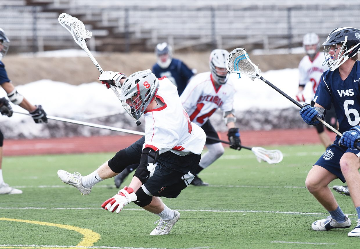 Steamboat Springs Tait Dixson is knocked to the ground while driving toward the goal during Monday evening's boys lacrosse game against Vail Mountain. Dixson may have gotten knocked down on the play, but the Gore Rangers couldn't keep the Steamboat senior down. He finished with a team high of six goals.