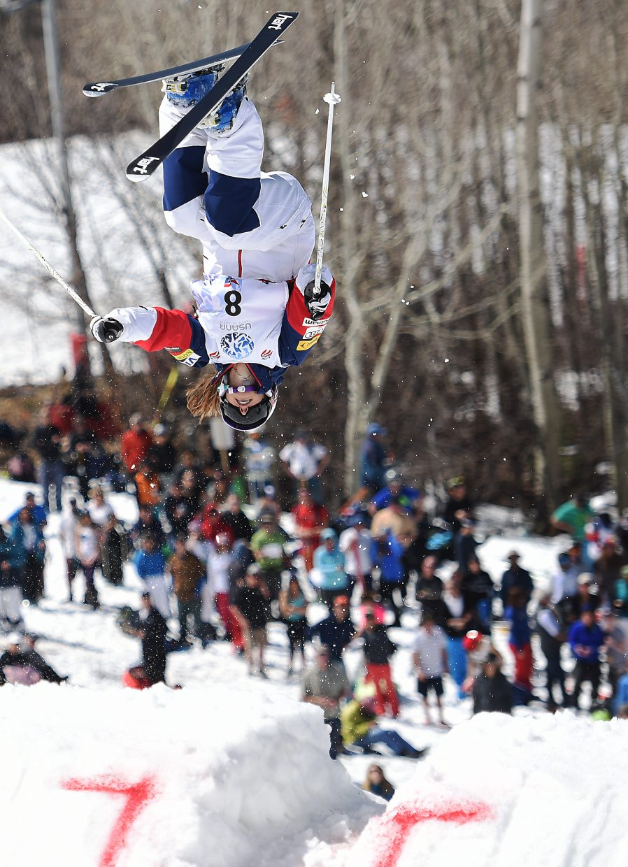 Steamboat skier Lane Stoltzner flips in front of the crowd at Sunday's U.S. Freestyle National Championships in Steamboat Springs.