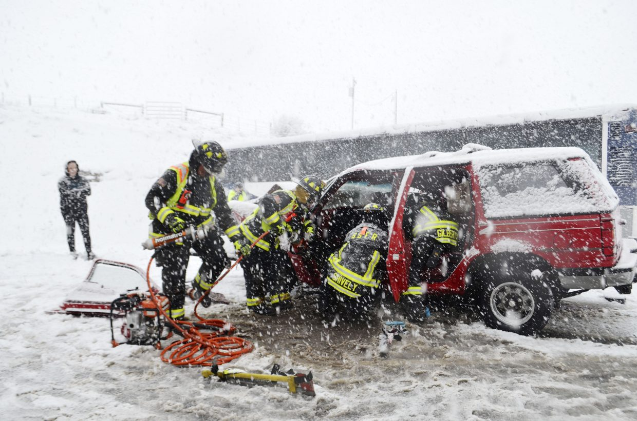 Steamboat Springs Fire and Rescue personnel work to extricate an occupant from a Ford Explorer Tuesday evening following an accident involving a city transit bus. Several people were transported with injuries, one of them considered to be serious.