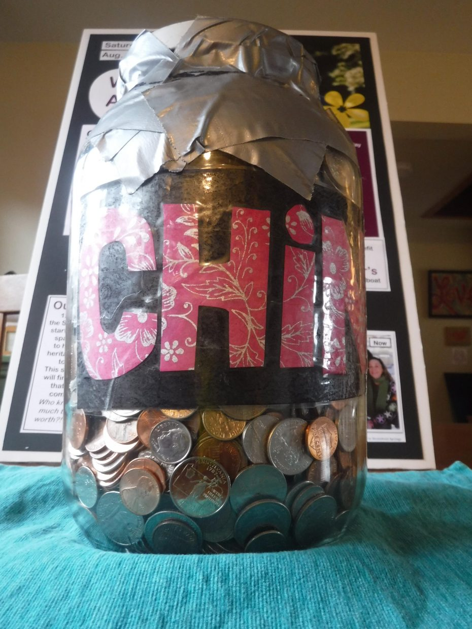 The jar of change the Stromans plan to use during their upcoming trip to China.