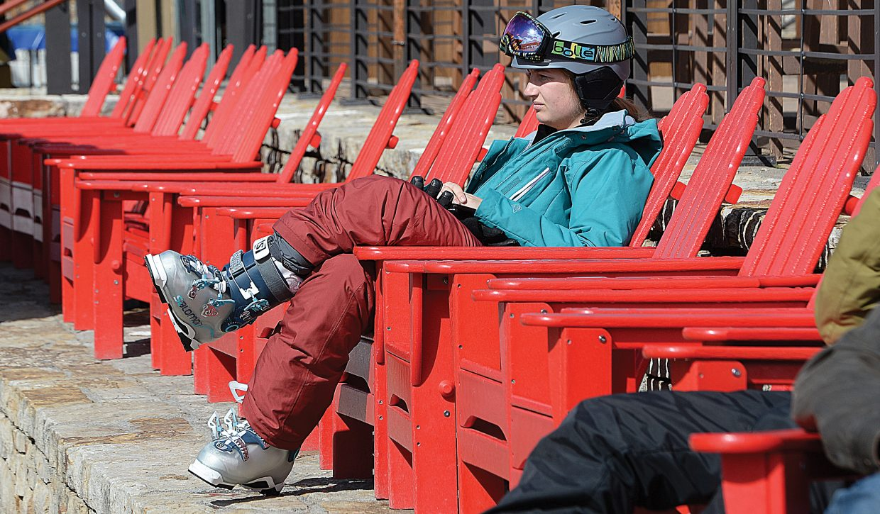 Cara Henderson enjoys the sun Wednesday afternoon at the base of Steamboat Ski Area. Henderson, a teacher from Denver, was spending the week in Steamboat Springs during spring break.