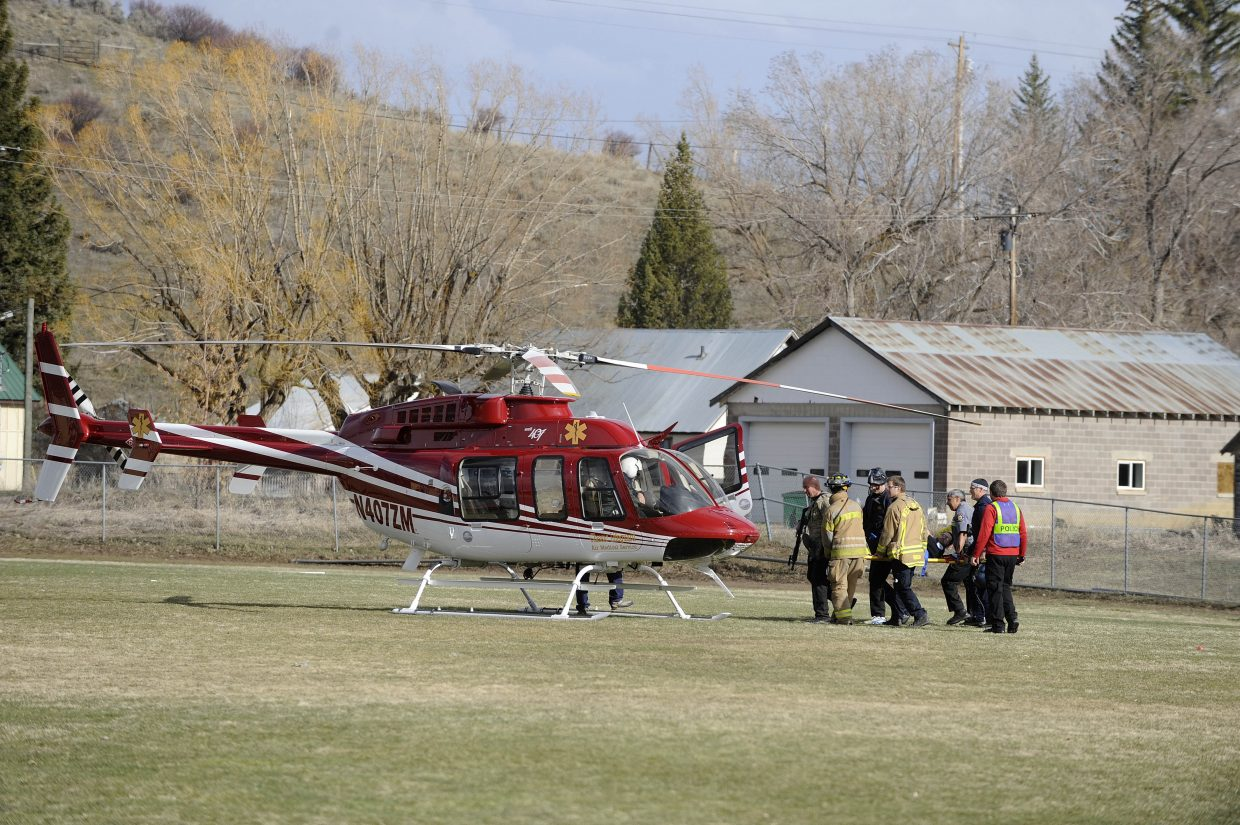 A mock patient is brought to a Classic Lifeguard air ambulance on the Hayden High School football field Wednesday.