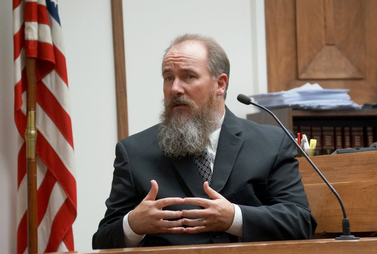 Bhrent Shock, a former Moffat County Sheriff's Department deputy who was allegedly taken hostage by Brent James Damon and Georgie Hand on March 9, 2015, testifies.