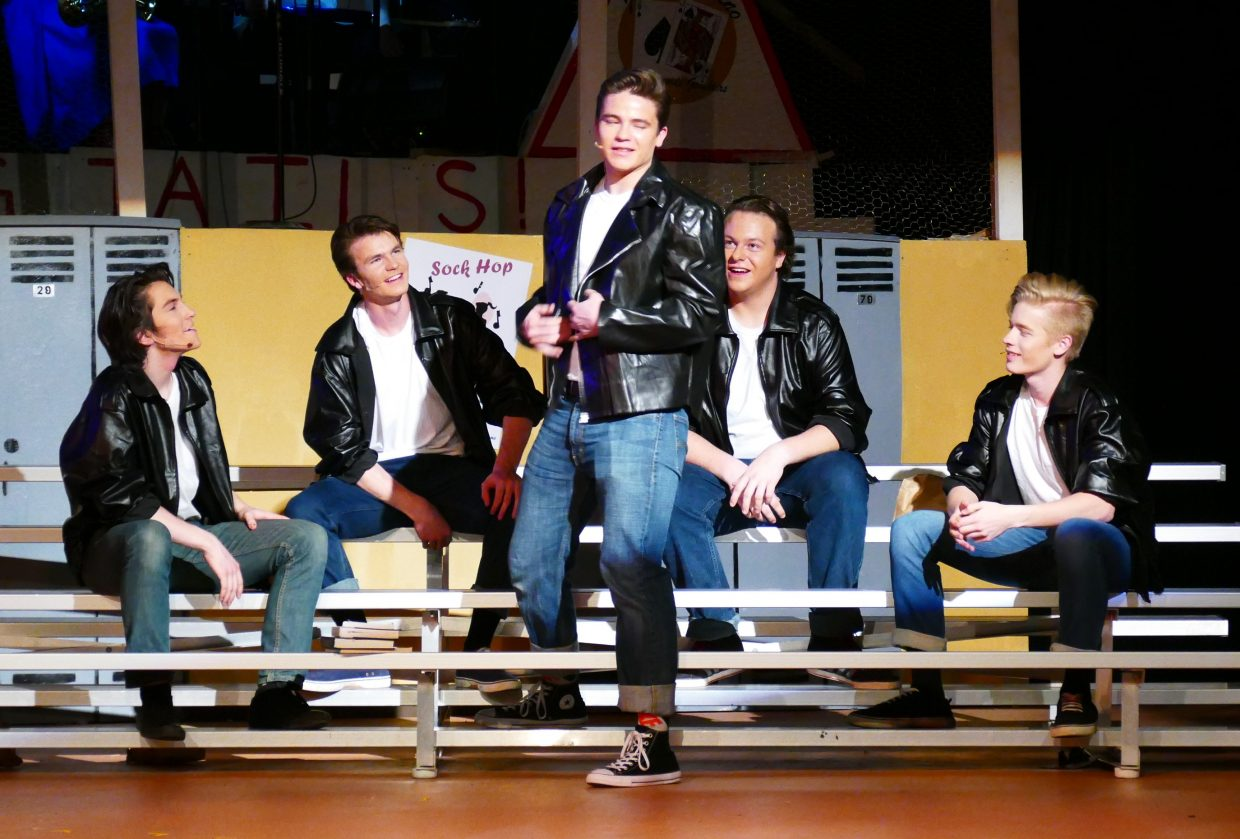 Steamboat Springs High School senior Charlie Harrington as Danny Zuko, and the T-Birds during a scene from last week's dress rehearsal of Grease.