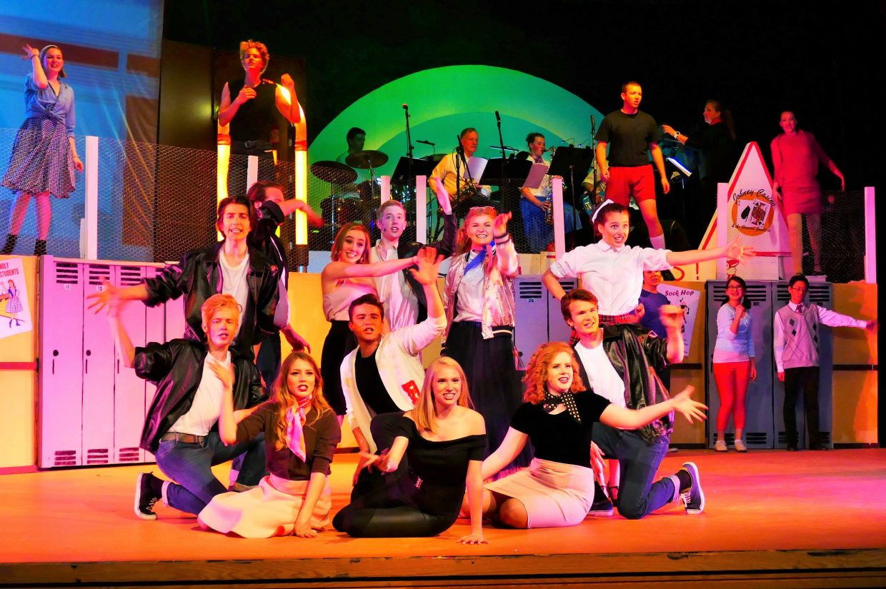 The Pink Ladies and T-Birds together in a scene from Grease.